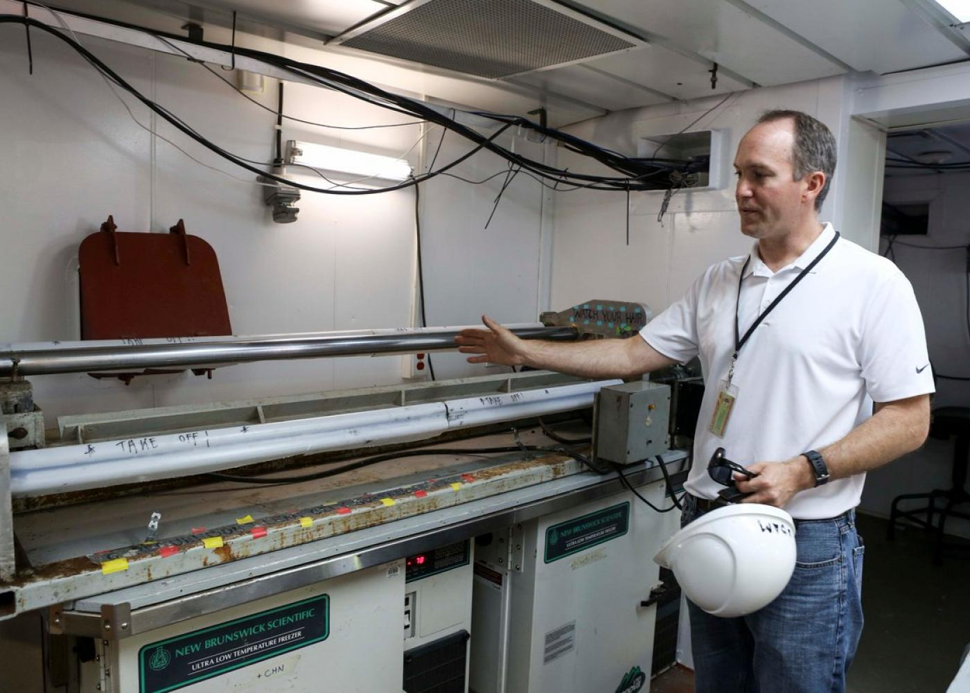 Adam MacDonald, NS Department of Energy & Mines, examines a core sample taken during an offshore coring cruise